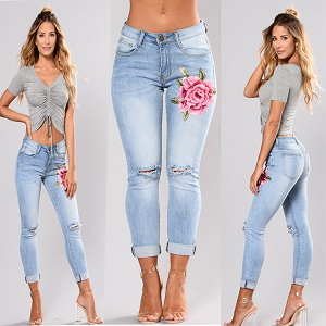 Wholesale fashion hole rose embroidery jeans leggings woman