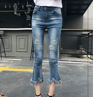 Wholesale flower embroidery hollow-out tassel micro flared jeans