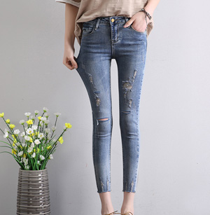 Wholesale Nine points jeans hole pencil pants burrs feet