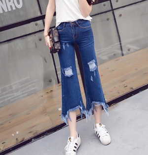 Wholesale holes worn irregular tassel flare jeans