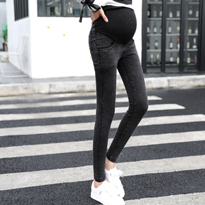 High-rise slim feet frizzled stretch jeans