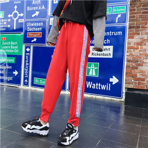 Side color matching striped letter bunch foot casual nine pants